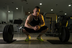 Back Exercise With Barbell In Fitness Center. Young Bodybuilder Doing Heavy Weight Exercise For Back With Barbell In Modern Gym Stock Images