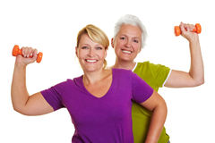 Back exercise with dumbbells. Happy senior women making fitness training with dumbbells Stock Images