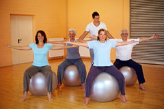 Back exercises with fitness trainer. Fitness group in gym doing back exercises Stock Photography
