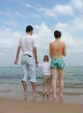 Back family of three. beach. Stock Photo