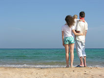 Back family of three on beach. Back family of three with son on beach Royalty Free Stock Photos