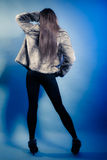 Back fashionable girl with long hair. Young woman in fur coat. Royalty Free Stock Image
