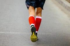 Back feet men runner Stock Photos