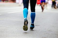 Back feet woman runner Stock Photo