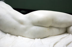 Back of femine marble statue. Royalty Free Stock Image