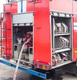 Back of the fire truck, hoses and equipment, red fire engine, special equipment and hydrants royalty free stock images