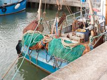Back of fishing boat with green fishing nets Royalty Free Stock Photo