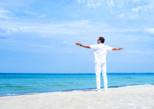 Back of a fit young man on the beach Stock Photography