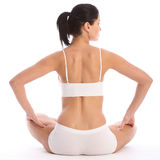 Back of fit young woman sitting in underwear Royalty Free Stock Photography