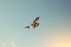 Back flip on a motorcycle, stunt biker make a back flip on a bik. Extreme sport Royalty Free Stock Images