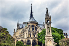 Back Flying Buttresses Overcast Notre Dame Paris France. Rear Back Overcast Skies Flying Buttresses Notre Dame Cathedral Paris France.  Notre Dame was built Stock Photo