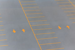 Back and forth. On a parking lot with yellow arrows and lines Stock Photo