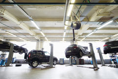 Back of four black cars in garage Royalty Free Stock Photography