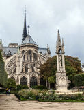 The back front of the Notre Dame de Paris church in a rainy day against the overcast sky Stock Photo