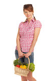 Back from the garden. Young girl with garden gifts in a basket Stock Image