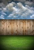 Back garden with wooden fence Royalty Free Stock Image
