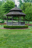 Back of gazebo with wood and steel benches. Royalty Free Stock Photo