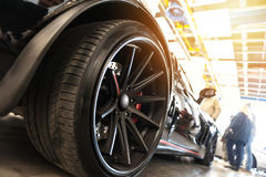 Back of a generic black sport car. In sunlight Royalty Free Stock Photography