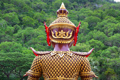 Back of giant guard at a temple of Thailand. Royalty Free Stock Image