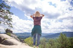 From the back a girl on a cliff royalty free stock photos