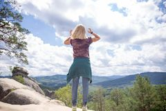 From the back a girl on a cliff stock photography