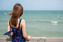 Back of a girl looking into the sea. The back of a girl looking into the sea Royalty Free Stock Photo