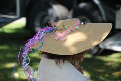 Back of girl's head with big hat Royalty Free Stock Images