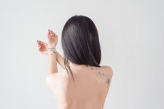 The back of a girl with a tattoo Royalty Free Stock Photo