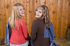 Back of girls turned and smiling Royalty Free Stock Photos