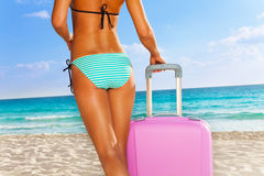 Back of gorgeous  tanned woman with pink luggage Royalty Free Stock Image