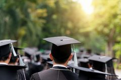 Back of graduates during commencement at university. Close up at. Graduate cap stock images