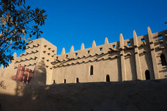 The back of the Great Mosque of Djenne, Mali. The Great Mosque of Djenné is the largest mud brick or adobe building in the world and is considered to be the Stock Image