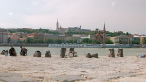 Back ground view of memorial Shoes on Danube Bank in Budapest, in sunny day
