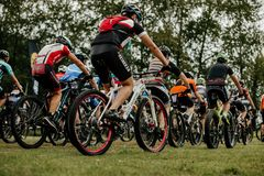 back group athletes mountain bikers cyclists start royalty free stock photos