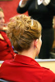 Back of hairstyle. Attractive young Caucasian blonde woman having hair styled for special event Stock Photography