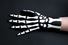 Back of hand painted to look like bones for halloween. A person`s hand painted black and white to look like a skeleton hand of bones royalty free stock image