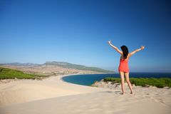Back happy woman at Bolonia beach Royalty Free Stock Photos