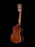 Back of hawaii ukulele guitar isolated. Against black background Stock Photos