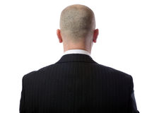 Back of head. Rear view of bald man wearing suit over white background Royalty Free Stock Photo