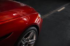 Back headlight of a modern luxury red car, auto detail, car care concept in the garage royalty free stock images