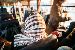 Back of Headscarf in the Bus with Sunlight at Vientiane, Laos Royalty Free Stock Image