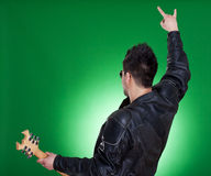 Back of a heavy metal guitarist Royalty Free Stock Image