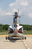 Back of helicopter parking at airfield. Rear view of helicopter parking at airfield Royalty Free Stock Photo