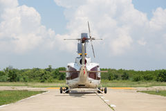 Back of helicopter parking at airfield. Rear view of helicopter parking at airfield Royalty Free Stock Image