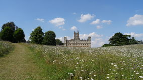 Back of Highclere Castle in flower field Royalty Free Stock Image