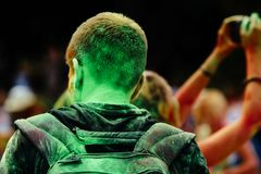 Back of hipster man all in colorful powder at holi fest, festiva Stock Image