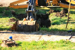 Back Hoe Digging Large Hole Royalty Free Stock Images