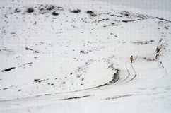Back home. On white snow, a person walking on the way home Stock Photos