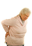 Back-hurt. Senior lady with back-hurt stock image