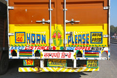 Back of an indian truck. Truck parked. Image of its vividly colored back with the message horn please. In India almost all the trucks have the back vividly stock images